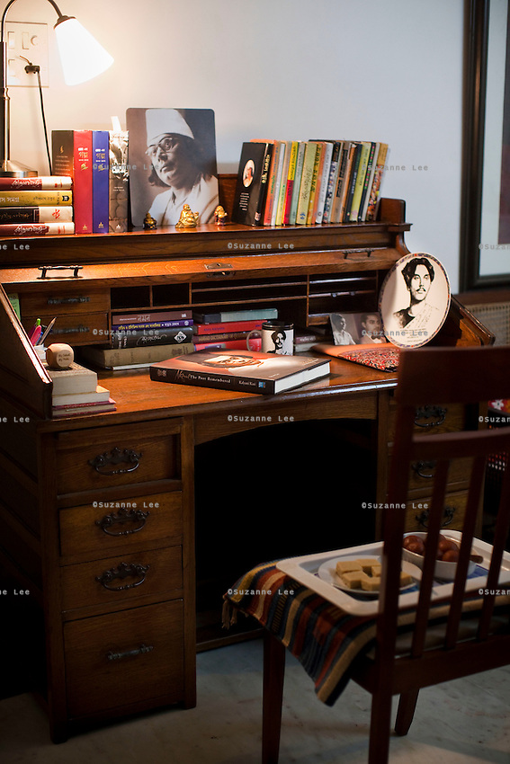 Anindita Kazi's reading desk stacked with books, many about her grandfather Nazrul Islam, in her house in Calcutta, West Bengal, India, on 17th January, 2012. The West Bengal government's attempts to rename one of its historic buildings after a Bengali poet has met with controversy. Kazi Nazrul Islam, Bangladesh's national poet's legacy has always been debated, including his relationship with other Indian intellectuals such as Rabindranath Tagore, who won the Nobel Prize for Literature in 1913. In an attempt to quell doubts, Anindita Kazi, Mr Islam's grand daughter will release a CD in which she reads from unpublished letters between the two poets to show their regard for each other. Photo by Suzanne Lee for The National (online byline: Photo by Szu for The National)