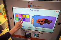 A Piecemaker Technologies 3d printer kiosk prints a Ford F-150 pick-up truck model at the 113th North American International Toy Fair in the Jacob Javits Convention center in New York on Sunday, February 14, 2016.  The printer is credit card operated for stores and mall. The company recently negotiated licensing rights to the Ford F-150. (© Richard B. Levine)
