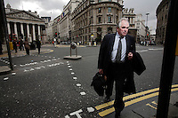 Sebastian, an office worker in the City of London, crosses the road opposite the Royal Exchange. The UK went into recession in the final quarter of 2008 as the City was hit hard by the global credit crunch.