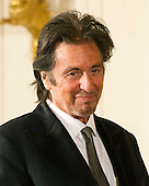 Al Pacino listens to the reading of the citation as United States President Barack Obama awards him the 2011 National Medal of Arts during a ceremony in the East Room of the White House in Washington, D.C. on Monday, February 13, 2012..Credit: Ron Sachs / Pool via CNP