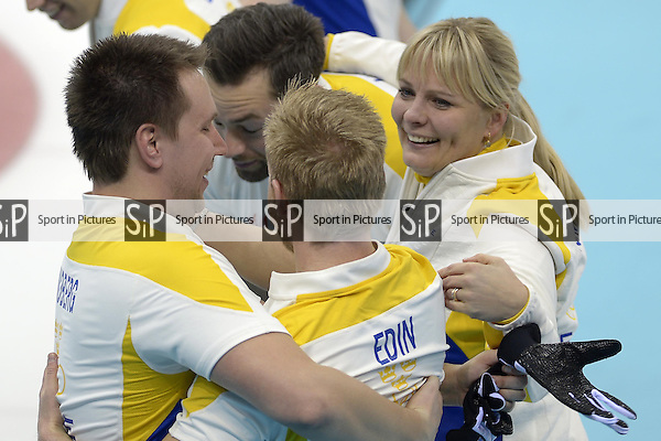 The Swedish team celebrate. (l to r)  Fredrik Lindberg (SWE), Sebastian Kraupp (SWE, vice skip), Niklas Edin (SWE, skip) and Swedish coach Eva Lund. Mens curling - Bronze medal match - SWE v CHN - Ice Cube Curling Centre - Olympic Park - PHOTO: Mandatory by-line: Garry Bowden/SIPPA/Pinnacle - Photo Agency UK Tel: +44(0)1363 881025 - Mobile:0797 1270 681 - VAT Reg No: 768 6958 48 - 210214 - 2014 SOCHI WINTER OLYMPICS - Ice Cube Curling Centre, Sochi, Russia