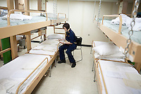 A member of the Navy's medical staff organizes paperwork on board the USNS Comfort, a naval hospital ship, before its mission to help survivors of the earthquake in Haiti on Monday, January 18, 2010 in the Atlantic Ocean off the coast of the United States on Sunday, January 17, 2010 in the Atlantic Ocean off the coast of the United States.