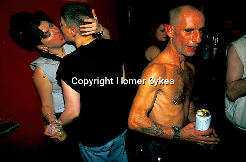 'GAYFEST MANCHESTER, UK', THE HOLLYWOOD SHOWBAR AND DISCO LESBIAN LOVERS AND A GAY REVELLER,