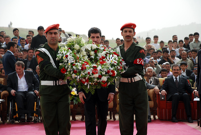 CHAMCHAMAL, IRAQ: Nechirvan Barzani lays wreath at the funeral ceremony of 104 Kurds discovered in a mass grave...On April 15, 2010, Iraqi Kurds held a ceremony to honor the 102 children and 2 pregnant women discovered in a mass grave near the town of Dibis.  They are believed to have been killed in the 1988 Anfal genocidal campaign against Iraq's Kurds.