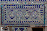 Detail of tiles on the wall of the courtyard of the Mikhmankhana, official reception hall, Tash Khauli Palace, 1830-38, Khiva, Uzbekistan, Khiva, Uzbekistan, pictured on July 7, 2010, in the afternoon. Commissioned by Allah Kuli Khan the Tash Kauli palace is a huge complex containing 163 rooms which took its architects, Tajiddin and Kalandar, 10 years to build. Khiva, ancient and remote, is the most intact Silk Road city. Ichan Kala, its old town, was the first site in Uzbekistan to become a World Heritage Site(1991). Picture by Manuel Cohen.