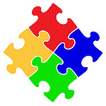 Artistic abstract symbol of four interconnecting puzzle pieces