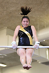 A member of the Mountain View High School gymnastics team participates in the high bar event.