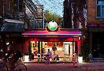 Editorial Travel Photography: Le Bilboquet Ice cream store on Laurier Avenue at dusk, Plateau Mont Royal, Montreal, Quebec, Canada