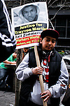 A boy attends a OWS protest with a poster demanding justice for the death of Florida teen Trayvon Martin in New York, United States. 24/03/2012.  Photo by Eduardo Munoz Alvarez / VIEWpress.