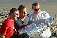 Aug 24, 2002: Detroit Red Wings hockey player Sean Avery poses with Actor/Director Chad Lowe along with Detroit Red Wings goaltender Kris Draper as they hold the NHL Stanley Cup on the beach at the Pacific Ocean.