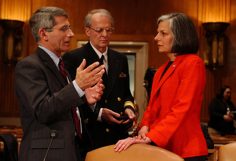 sars1/040703 -- At left, Dr. Anthony Fauci, director of the National Institute of Allergy and Infectious Diseases speaks with James M. Hughes, director National Center for Infectious Diseases, and Dr. Julie Gerberding, director of the Centers for Disease Control and Prevention, prior to testifing before a Senate Committee on Health, Education, Labor and Pensions, on the threat of the Severe Acute Repiratory Syndrome Threat, SARS, to the United States.