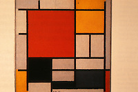 "Gerrit Rietveld: Schroder House. Background, a painting by Piet Mondrian, ""Composition with Red, Yellow, Blue and Black"", 1921."