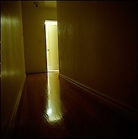 Light coming from within room with partially opened door