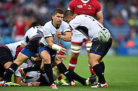 Valentin Calafeteanu of Romania passes the ball. Rugby World Cup Pool D match between Canada and Romania on October 6, 2015 at Leicester City Stadium in Leicester, England. Photo by: Patrick Khachfe / Onside Images