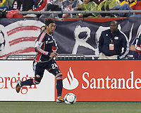 New England Revolution midfielder Lee Nguyen (24) brings the ball forward. In a Major League Soccer (MLS) match, the New England Revolution (blue) tied New York Red Bulls (white), 1-1, at Gillette Stadium on May 11, 2013.