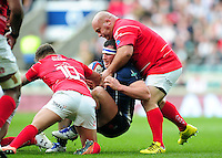 Sgt Gareth Evans of the Royal Navy is tackled by LCpl James Dixon and LCpl Chris Budgen of the British Army. Babcock Inter-Services Championship match between the British Army and the Royal Navy on April 30, 2016 at Twickenham Stadium in London, England. Photo by: Patrick Khachfe / Onside Images