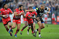 Jonathan Joseph of Bath Rugby takes on the Toulon defence. European Rugby Champions Cup match, between Bath Rugby and RC Toulon on January 23, 2016 at the Recreation Ground in Bath, England. Photo by: Patrick Khachfe / Onside Images
