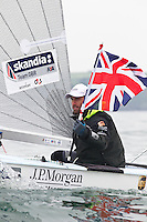 Ben Ainslie celebrates after winning The JP Morgan Asset Management Finn Gold Cup 2012. Falmouth.Credit: Lloyd Images