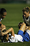 01 Aug 2009: Heather Mitts (ground) of the Breakers is in pain after an injury to her left knee as teammates Kristine Lilly (right) and Angela Hucles (left) console her.  Saint Louis Athletica defeated the visiting Boston Breakers 1-0 in a regular season Women's Professional Soccer game at Anheuser-Busch Soccer Park, in Fenton, MO.