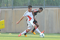 Diego Fagundez (14) of the New England Revolution shields the ball against James Riley (14) of D.C. United. D.C. United defeated the The New England Revolution 3-1 in the Quarterfinals of Lamar Hunt U.S. Open Cup, at the Maryland SoccerPlex, Tuesday June 26 , 2013.