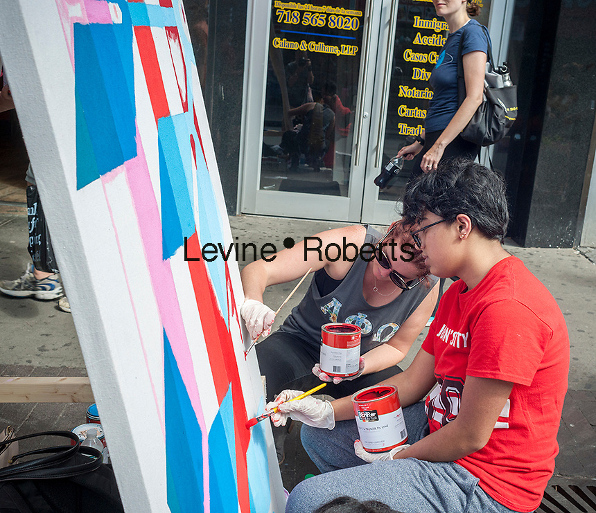 College students volunteer to paint murals toe beautify the Jackson Heights neighborhood in Queens in New York on Saturday, September 17, 2016. The Jackson Heights neighborhood is home to a mosaic of ethnic groups beside Indians which include Pakistanis, Tibetans, Southeast Asian and long-time Jewish and Italian residents.  (© Richard B. Levine)