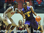 "LSU's Malcolm White (5) works against Mississippi's Demarco Cox (4) at the C.M. ""Tad"" Smith Coliseum in Oxford, Miss. on Saturday, February 25, 2012. (AP Photo/Oxford Eagle, Bruce Newman).."