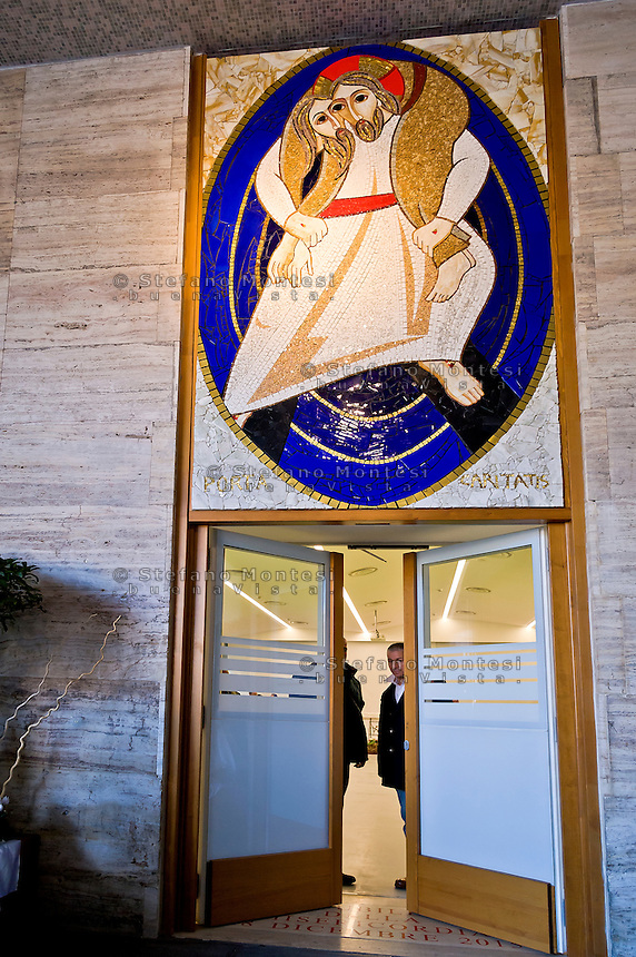"ROME, ITALY - NOVEMBER 12:  Two guests of the hostel Caritas close the Holy Door during the ceremony Jubilee  for  closed Holy Door of Charity at Caritas hostel ""Don Luigi Di Liegro"". Cardinal Pope's vicar for the Diocese of Rome, Agostino Vallini, has chaired this morning's Mass for the closing of the Holy Door of Charity on November 12, 2016 in Rome, Italy. Open December 18, 2015 by Pope Francis - the first in the history of Jubilees that does not introduce in basilicas, cathedrals and churches, was crossed by over 12 thousand pilgrims."