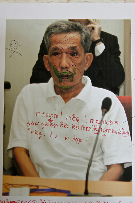 A photo of Kang Kek Iew, also known as Comrade Duch, undergoing trial has been defaced at the Tuol Sleng prison in Phnom Penh, Cambodia. Duch was the Khmer Rouge's chief of internal security and commander of Tuol Sleng. He surrendered to authorities in 1999 after years of hiding, was indicted by the UN-backed Khmer Rouge Tribunal in 2007. He is the only one out of the five high-ranking former regime officials who are on trial to admit his guilt. Charged with genocide, crimes against humanity, and personally overseeing more than 15,000 interrogations and executions at Tuol Sleng, he was initially sentenced to 35 years in prison. In Feb. 2012, another UN war crimes tribunal extended his sentence to life in prison. March 1, 2012