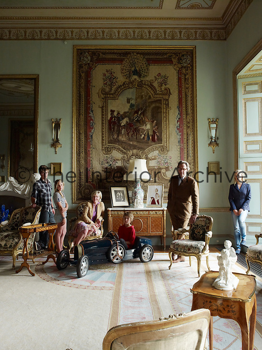 Lord and Lady March and their family in the Tapestry Drawing Room
