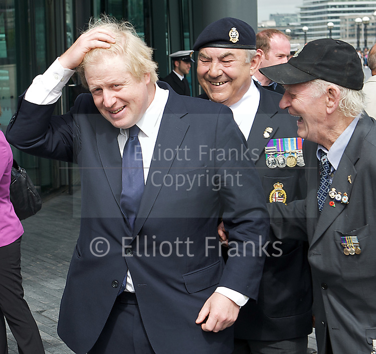 Raising the flag for Armed Forces Day <br /> at City Hall, London, Great Britain <br /> <br /> 20th June 2011<br /> <br /> Boris Johnson <br /> Mayor of London<br /> <br /> with some Veterans<br /> Photograph by Elliott Franks
