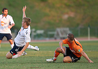 Jo Conner slides from behind taking out Bolton Wanderers Stuart Holden.  The Charlotte Eagles currently in 3rd place in the USL second division play a friendly against the Bolton Wanderers from the English Premier League.