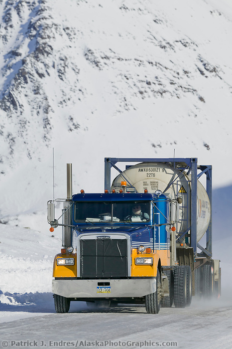 Semi tractor trailer hauls a load on the James Dalton highway in Atigun Canyon.