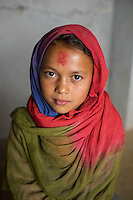 Nepal, Sindhulpalchowk District, Syaule Village.  Earthquake recovery and relief efforts during the summer monsoon rains. Families that lost their homes living in temporary shelters. Bikisha (7 years)