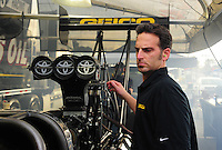 Jan. 17, 2012; Jupiter, FL, USA: Aaron Brooks crew chief for NHRA top fuel dragster driver Morgan Lucas (not pictured) during testing at the PRO Winter Warmup at Palm Beach International Raceway. Mandatory Credit: Mark J. Rebilas-