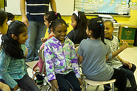 First and second graders play the game of musical chairs to learn Arabic at P.S. 368-Hamilton Heights School in Harlem in New York on Wednesday, May 23, 2012. The program is the first at the K-5 school level in New York City Public Schools.  © Frances M. Roberts)