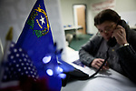 Volunteer Dorian McBride calls Republican voters at a Gingrich campaign phone bank in Reno, Nev., January 31, 2012.