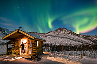 Aurora borealis over the Caribou Bluff recreation cabin in the White Mountains National Recreation Area, interior, Alaska.Aurora borealis over the Caribou Bluff recreation cabin in the White Mountains National Recreation Area, interior, Alaska.