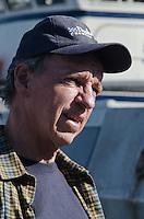 Duke Inspects the Halibut Catch, Kodiak Island, Alaska, May 2013
