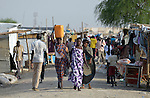 Displaced people walk inside a United Nations base in Malakal, South Sudan. More than 20,000 civilians have lived inside the base since shortly after the country's civil war broke out in December, 2013, but renewed fighting in 2015 drove another 5,000 people, including these people, into the relative safety of the camp.