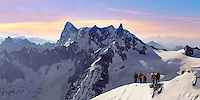 Climbers leaving Alguille du Midi for the Mont Blanc Massif, Chamonix Mont Blanc, France
