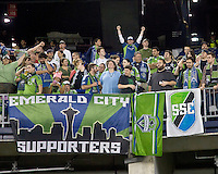 Seattle Sounders fans. In a Major League Soccer (MLS) match, the Seattle Sounders FC defeated the New England Revolution, 2-1, at Gillette Stadium on October 1, 2011.