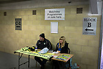 Forest Green Rovers 0 Tranmere Rovers 2, 17/10/2015, New Lawn, National League. Two people sitting at a table selling match programmes and souvenirs at the New Lawn, home to Forest Green Rovers, prior to their match against Tranmere Rovers in the National League. The club is based in the village of Nailsworth in Gloucestershire and is owned by businessmen Dale Vince who doesn't allow meat products to be sold to supporters in the ground. The visitors from Merseyside won this game by 2-0 but the hosts remained top of the division. Photo by Colin McPherson.