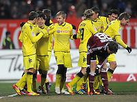 FUSSBALL   1. BUNDESLIGA  SAISON 2011/2012   20. Spieltag 1. FC Nuernberg - Borussia Dortmund         03.02.2012 Jubel nach dem Tor zum 0:1 Moritz Leitner , Shinji Kagawa ,  Lukasz Piszczek (v. li., Borussia Dortmund)