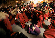 Wasco, Oregon, February 1984: Disciples of Bhagwan Rajneesh dancing during the Darshan Ceremony in Rajneeshpuram, where new members were baptized by a grand priest every Sunday evening. Rajneeshpuram, was an intentional community in Wasco County, Oregon, briefly incorporated as a city in the 1980s, which was populated with followers of the spiritual teacher Osho, then known as Bhagwan Shree Rajneesh. The community was developed by turning a ranch from an empty rural property into a city complete with typical urban infrastructure, with population of about 7000 followers.
