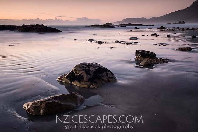 Sunset at Woodpacker Bay near Punakaiki, Paparoa National Park, West Coast, New Zealand
