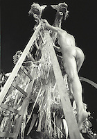 Carnival, Rio de Janeiro, Brazil. Samba Schools Parade - Nude sensual woman going down from platform on wheels ( float - carro alegorico ) after parade.