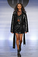 Model walks runway in an outfit by Sarah Valin, during the Future of Fashion 2017 runway show at the Fashion Institute of Technology on May 8, 2017.