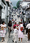 Shoppers walk down Praia's main street on Terceira, Azores. Far out in the Atlantic Ocean, some 850 miles off the western coast of Lisbon, Portugal lies the 425-mile long archipelago of the Azores. (Jim Bryant Photo).....