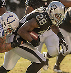 Oakland Raiders running back Latavius Murray (28) run with ball on Saturday, December 24, 2016, at O.co Coliseum in Oakland, California.  The Raiders defeated the Colts 33-25.