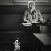 Man and his dog having lunch at a restaurant in Torshavn Faeroe islands